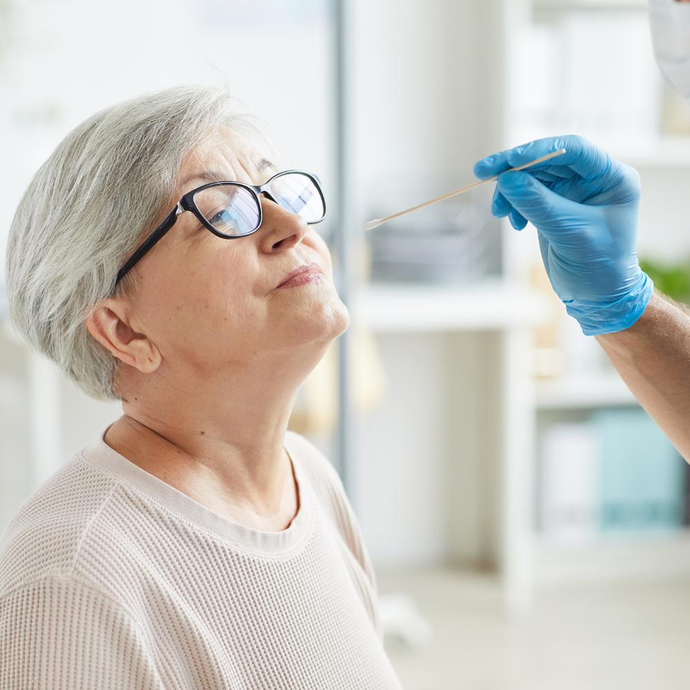 Doctor testing woman