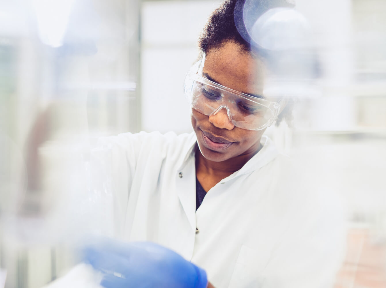 Image of a woman in a laboratory conducting testing