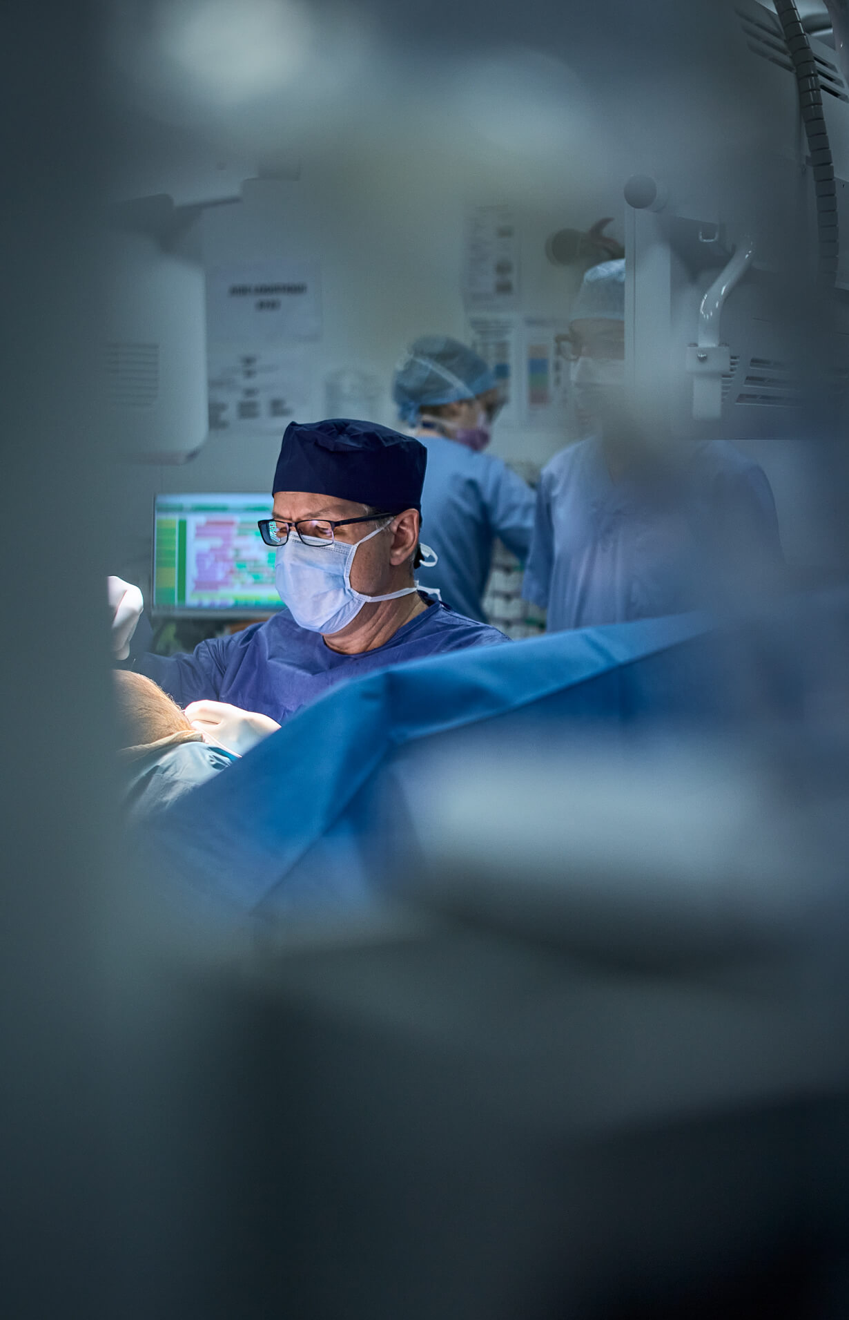 Portrait of Dr. Ioan Dunca during surgery