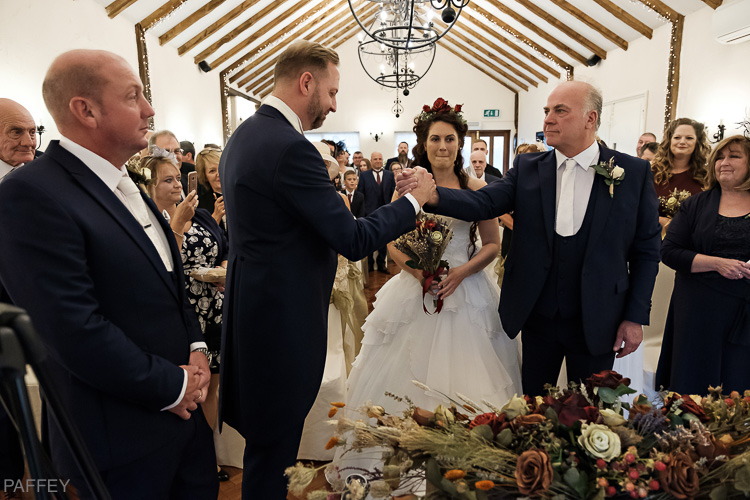 Dad giving his daughter away at her wedding