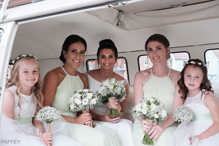 bride and her bridesmaids in a camper van