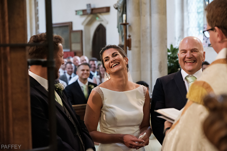 laughing bride during wedding service