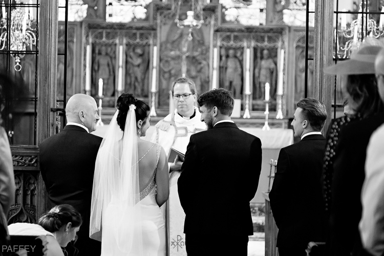 bride and groom photographed from behind in church