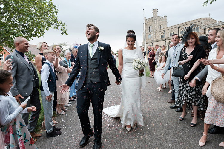 bride and groom during confetti shower