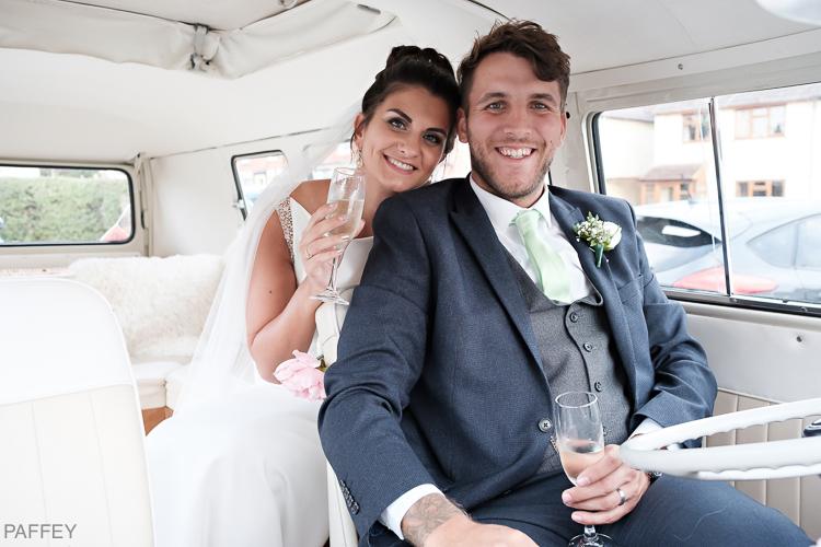 happy bride and groom inside wedding camper van
