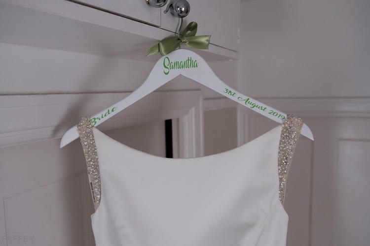 wedding dress on its hanger