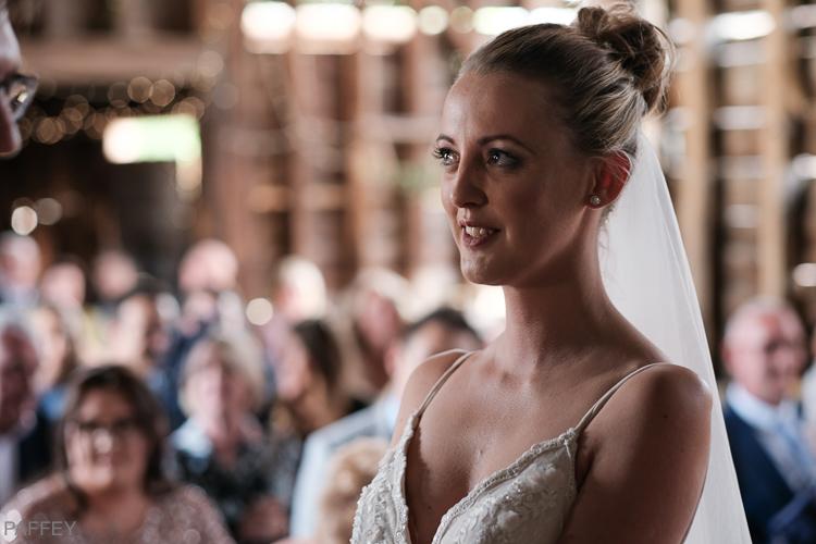 tearful looking bride getting married