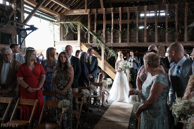 bride arrival at a barn wedding
