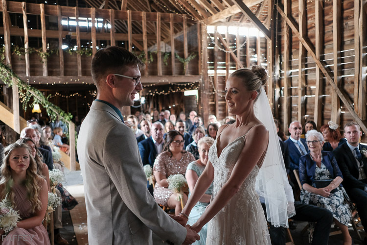 happy bride and groom in a barn