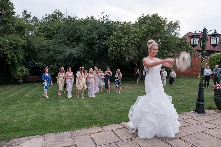 bride tossing her wedding bouquet