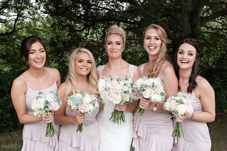 laughing bride with her bridemaids