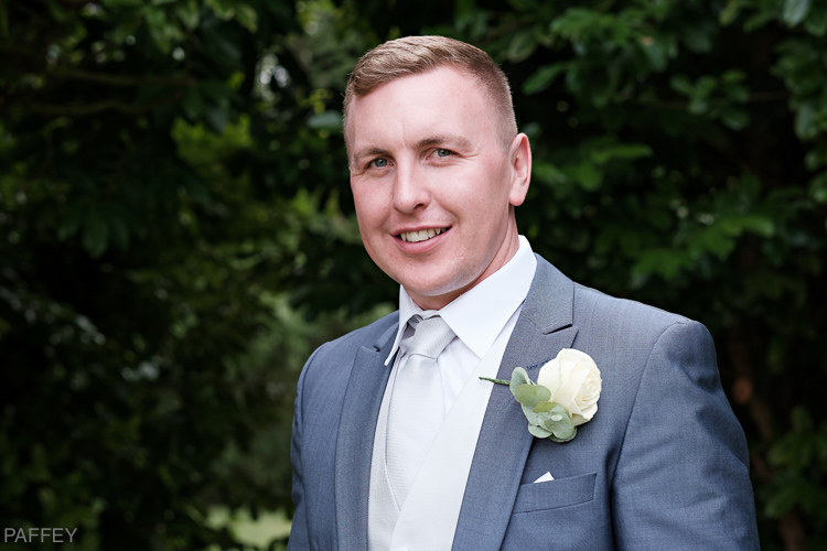 photo of handsome groom
