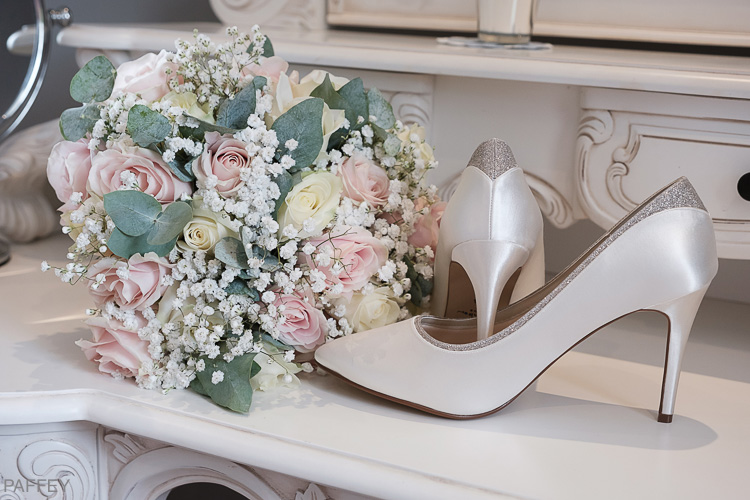 brides bouquet and wedding shoes