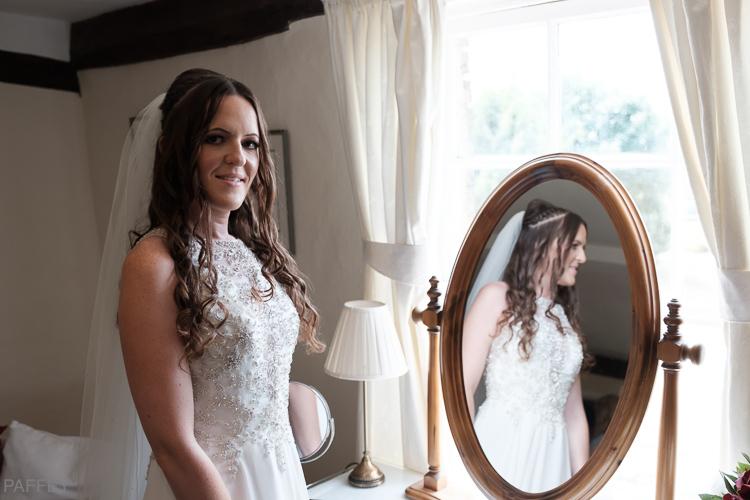 bride reflecting in a mirror