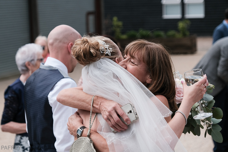 bride being hugged by her auntie