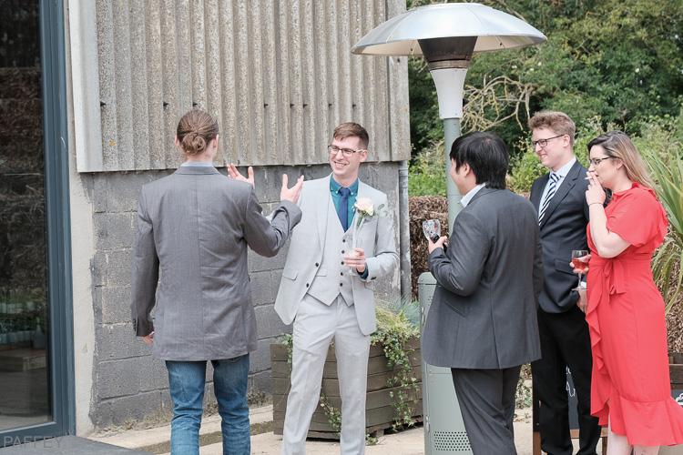 groom meeting his friends