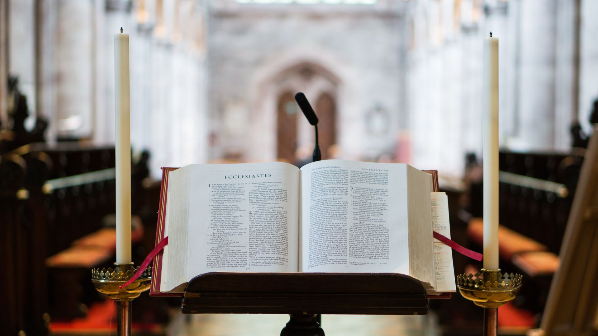 Bible sitting open at the altar of a church