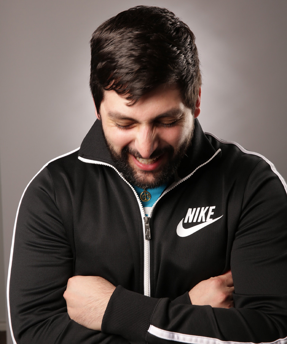 Photograph of Salim Sidani looking down and wearing a Nike jacket.