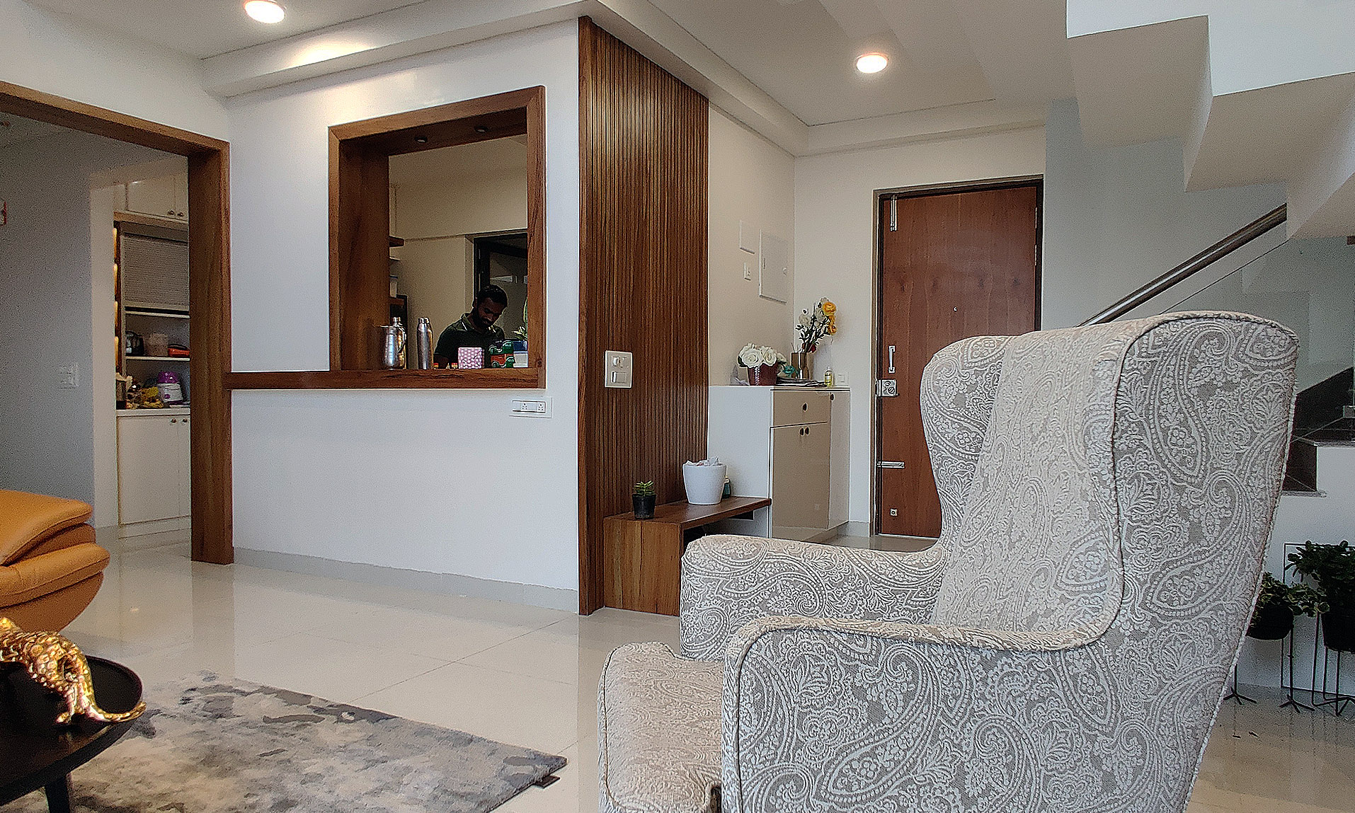 accent chair in living room and kitchen design