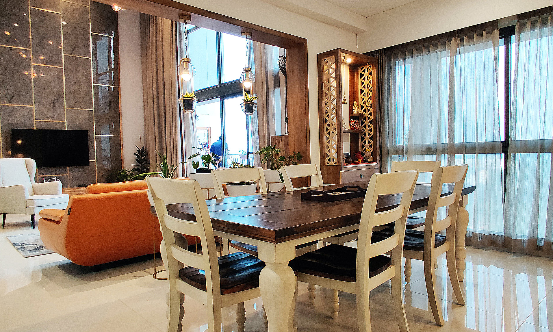 Dining table in white with a puja unit in jali