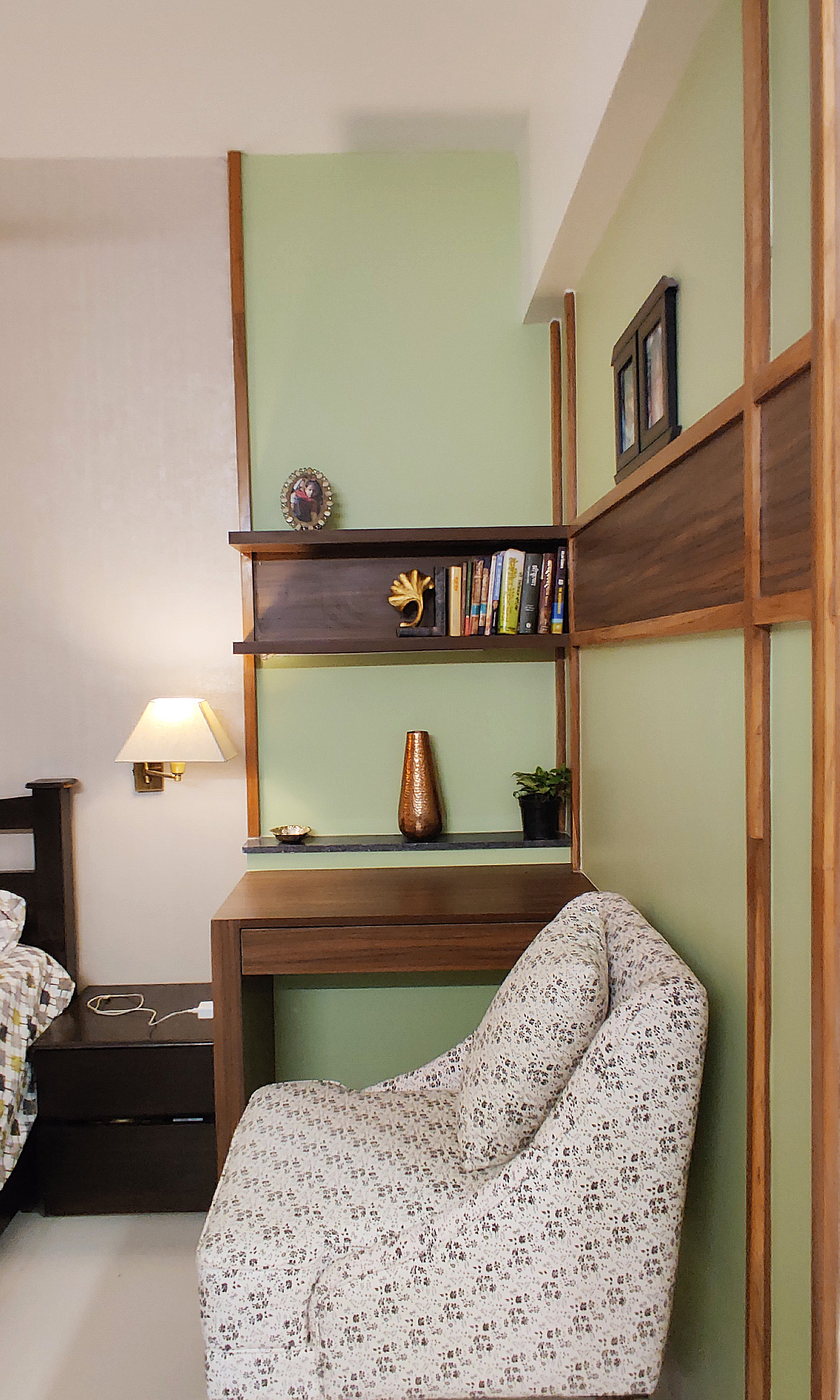 study space with wall beading with wood shelves
