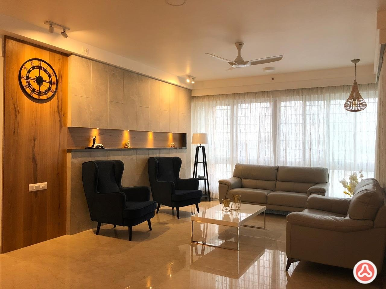 Living room wing wallpaper and highbacked seating