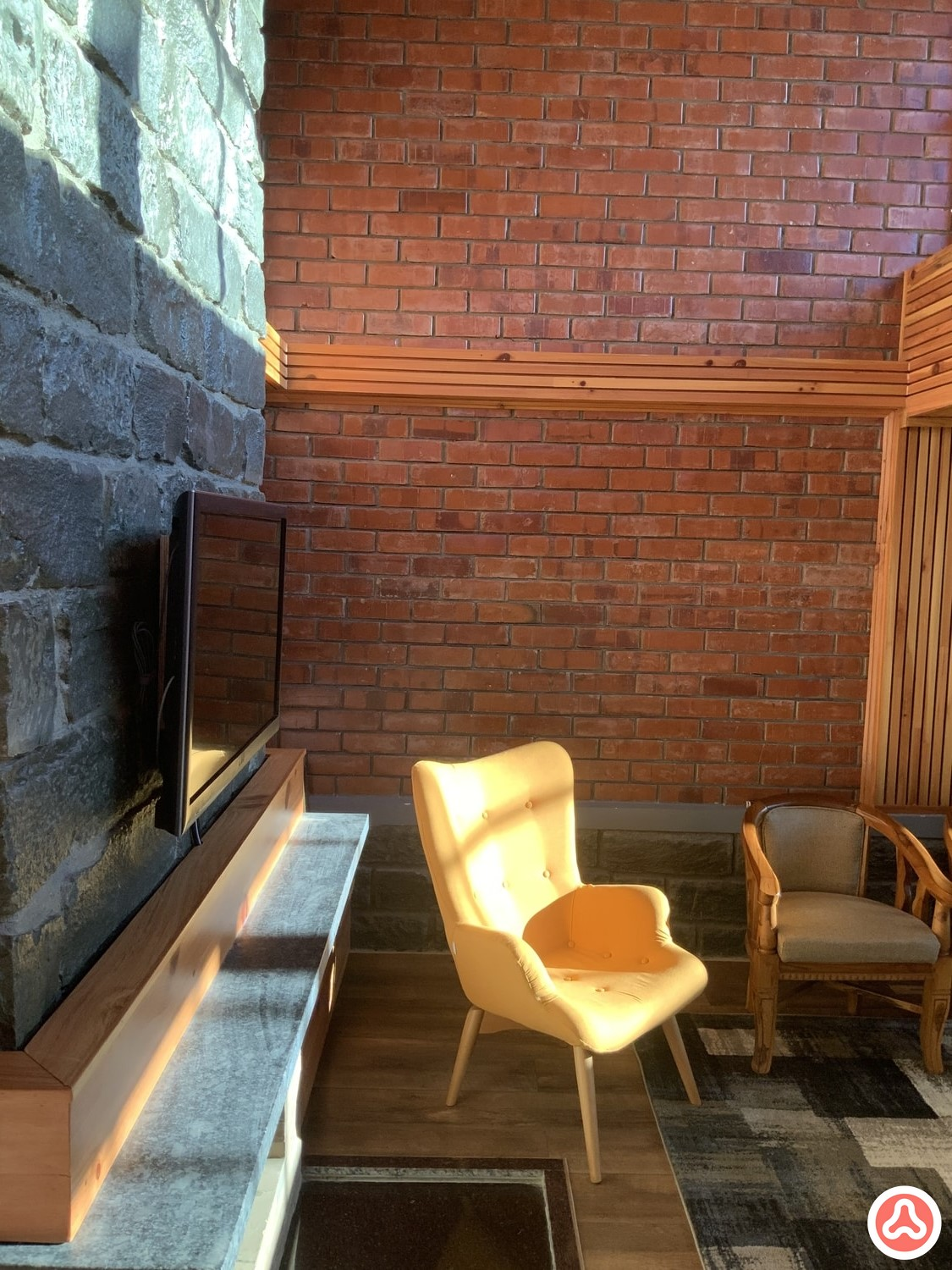 Fire place with a chair and tv unit design
