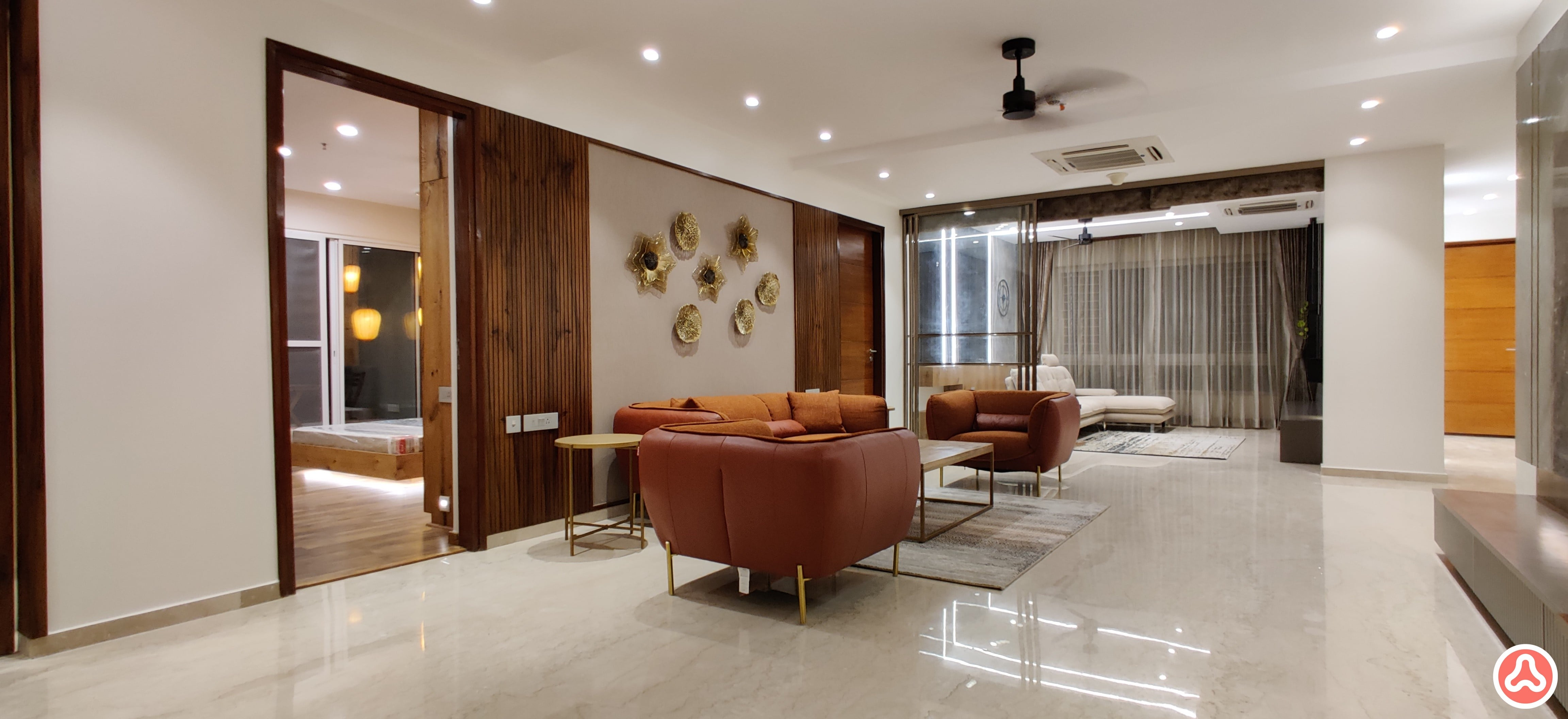 Premium living room with wall paper and leather sofa for a 4 bhk apartment in hydrabad