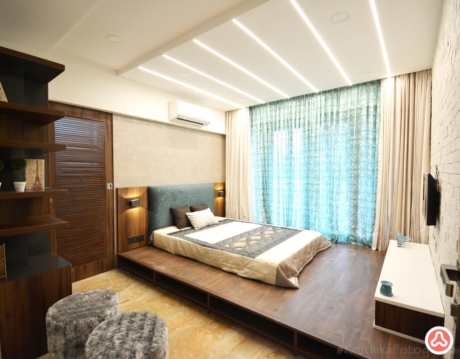 Apartment bedroom interior design with strip lights in ceiling, and headboard in fabric