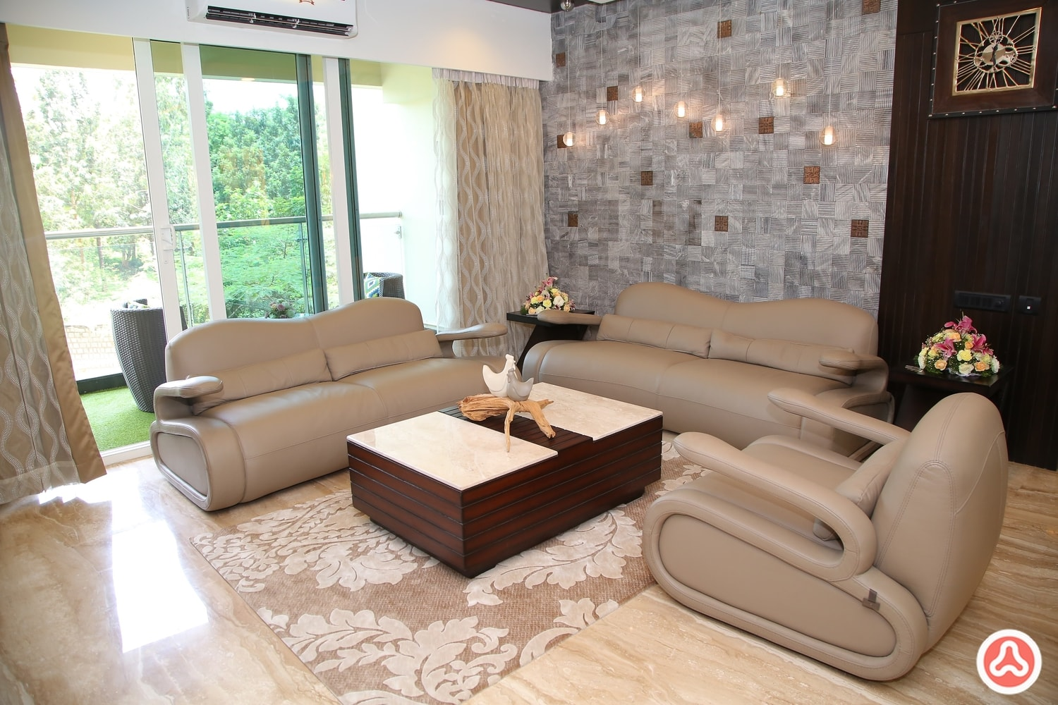 Living room with the stone cladding on the wall and sofa seating arranged around the wooding center table