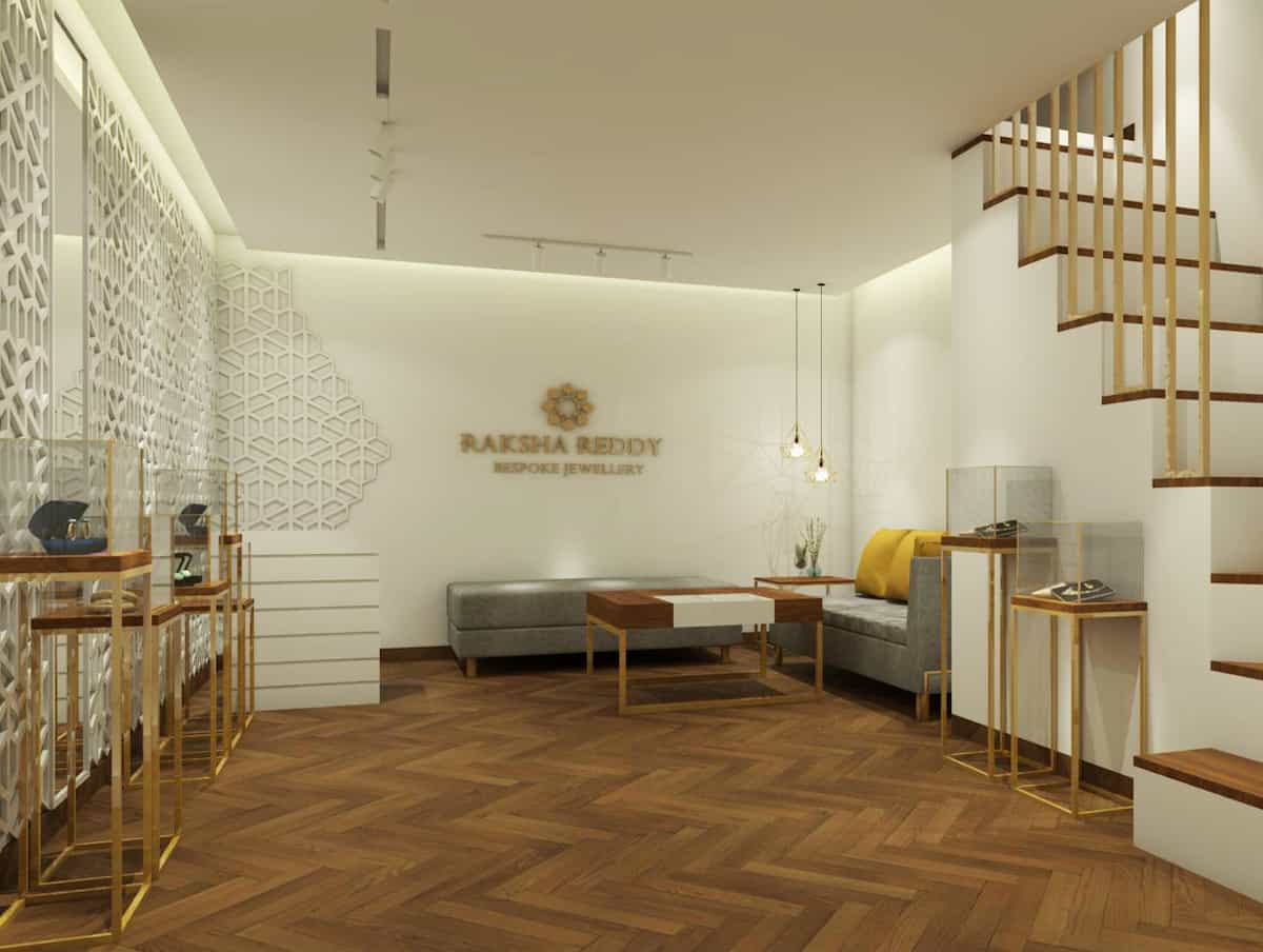 Jewelry store interiors done in wood flooring and white duco painted walls, with golden trims