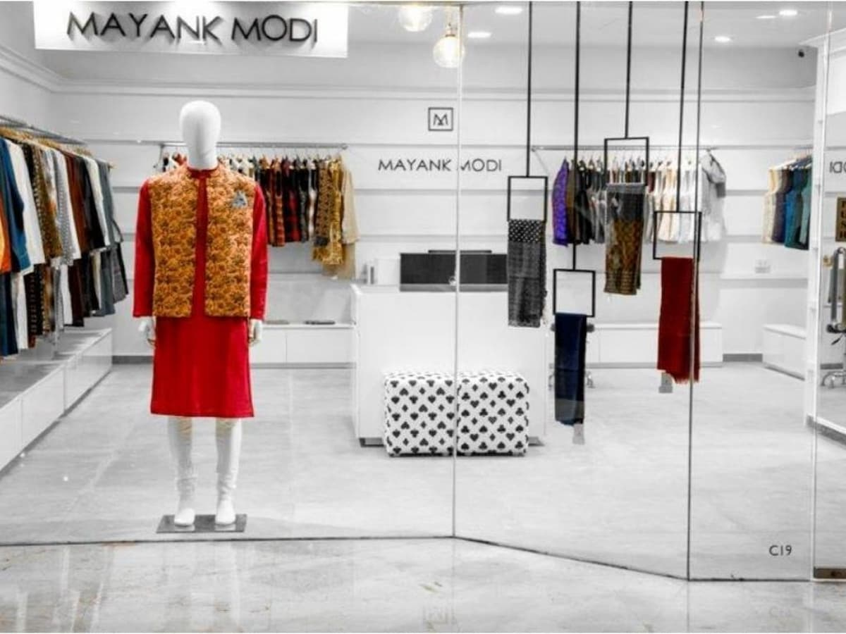 Store front for designer clothing brand designed in premium white