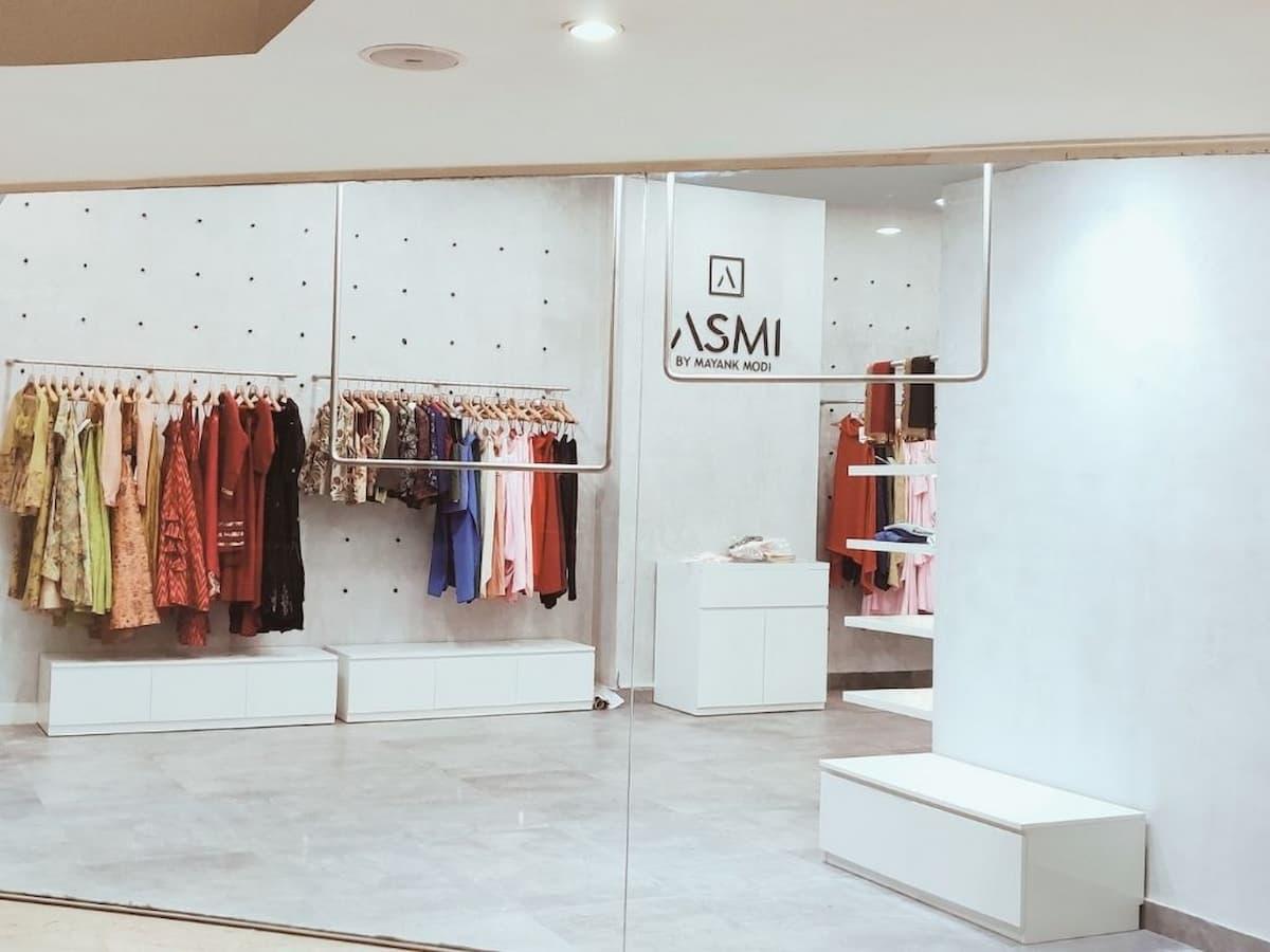Asmi designer store with industrial design walls