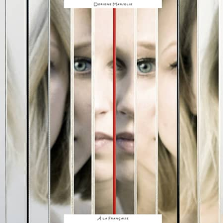 A album cover of doriene Marselje. cut up images of a portrait of her face.