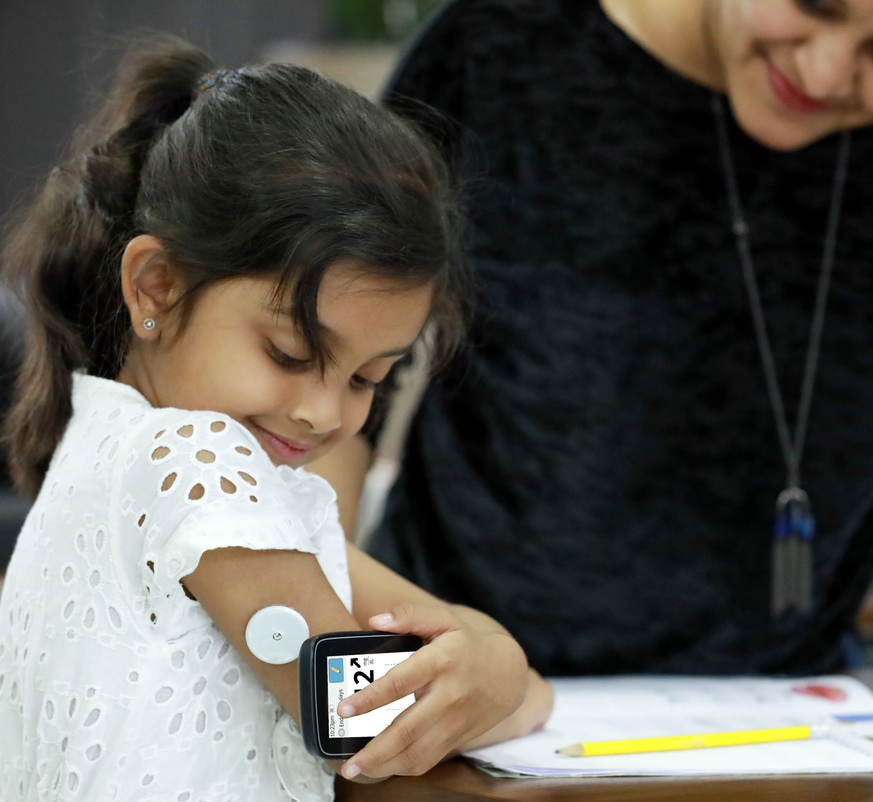 Young girl testing glucose levels