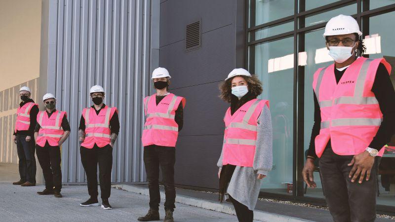 Garden Studios Team Outside the IRIS Studio Wearing Masks