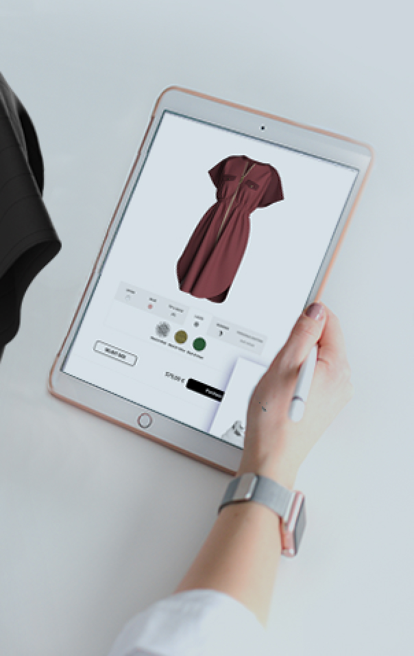 A woman hand holding an iPad showing a red drees in a platform for customization