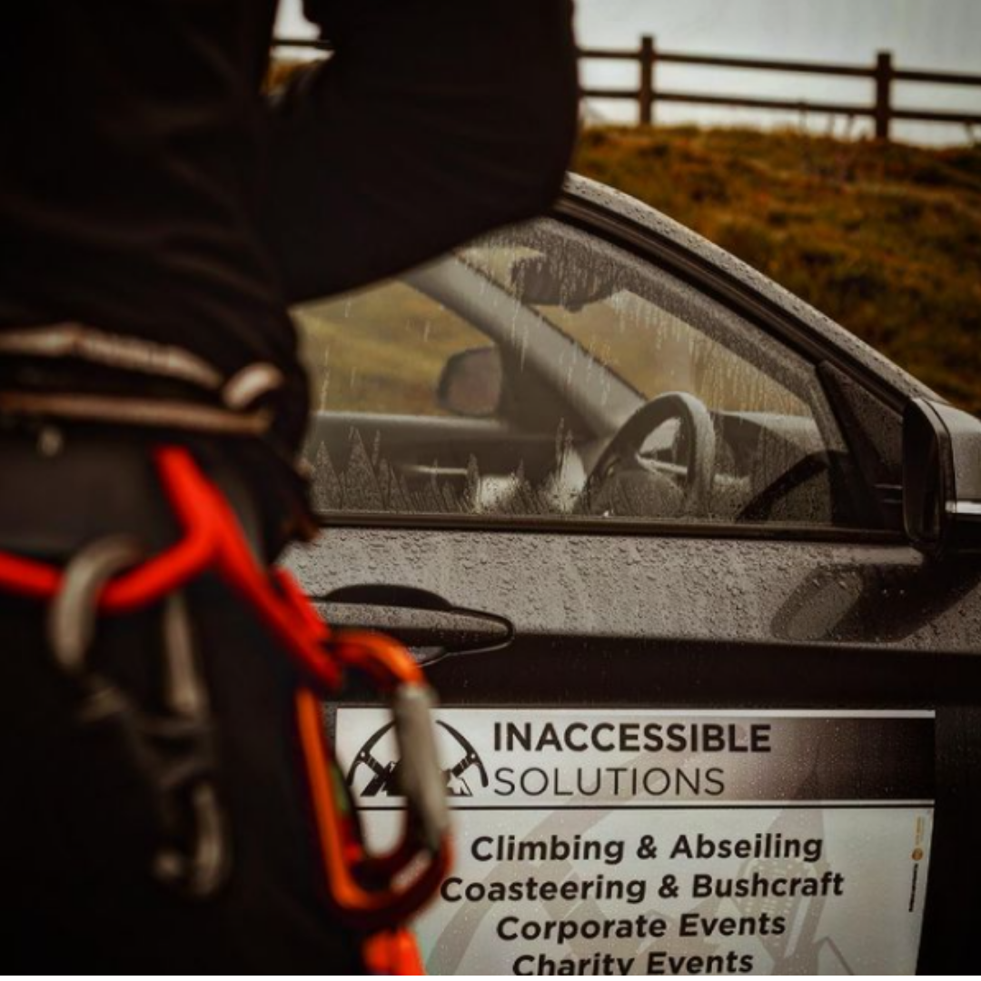inaccessible solutions branding on car climbing abseiling events
