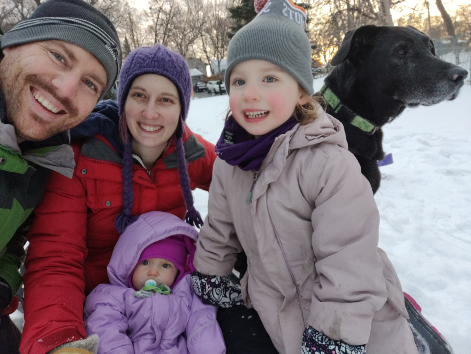 Leana in the snow with her husband, 2 kids, and dog.