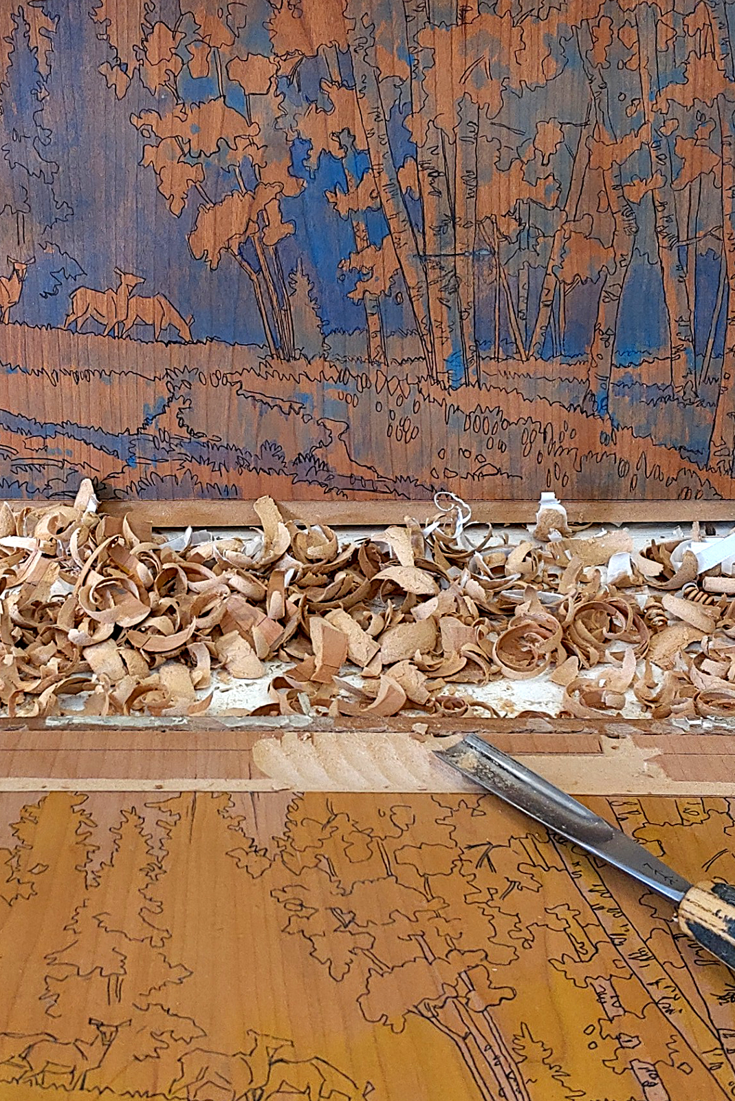 The carve process on a woodblock