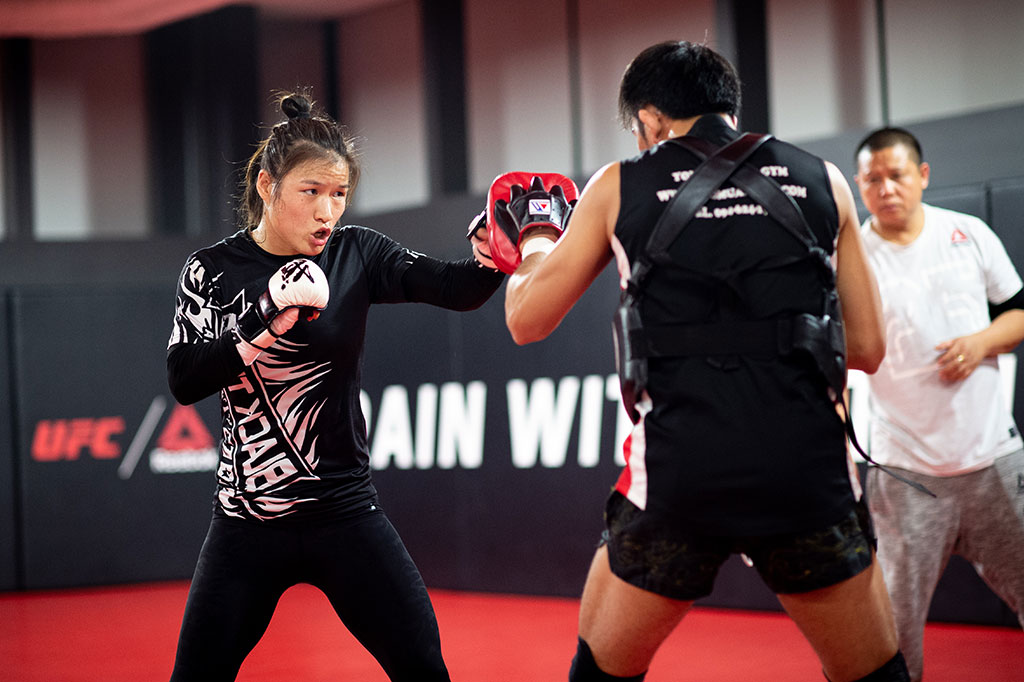 UFC Academy athletes being coached