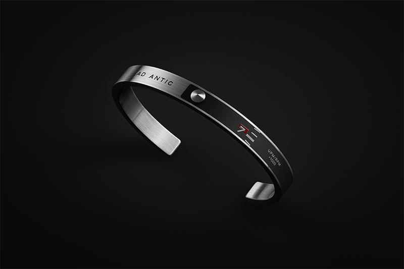 a bracelet against a black background