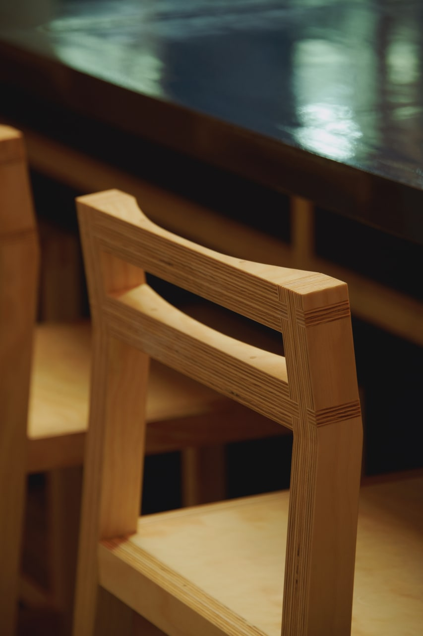 A closeup of the wooden chair inside the restaurant.