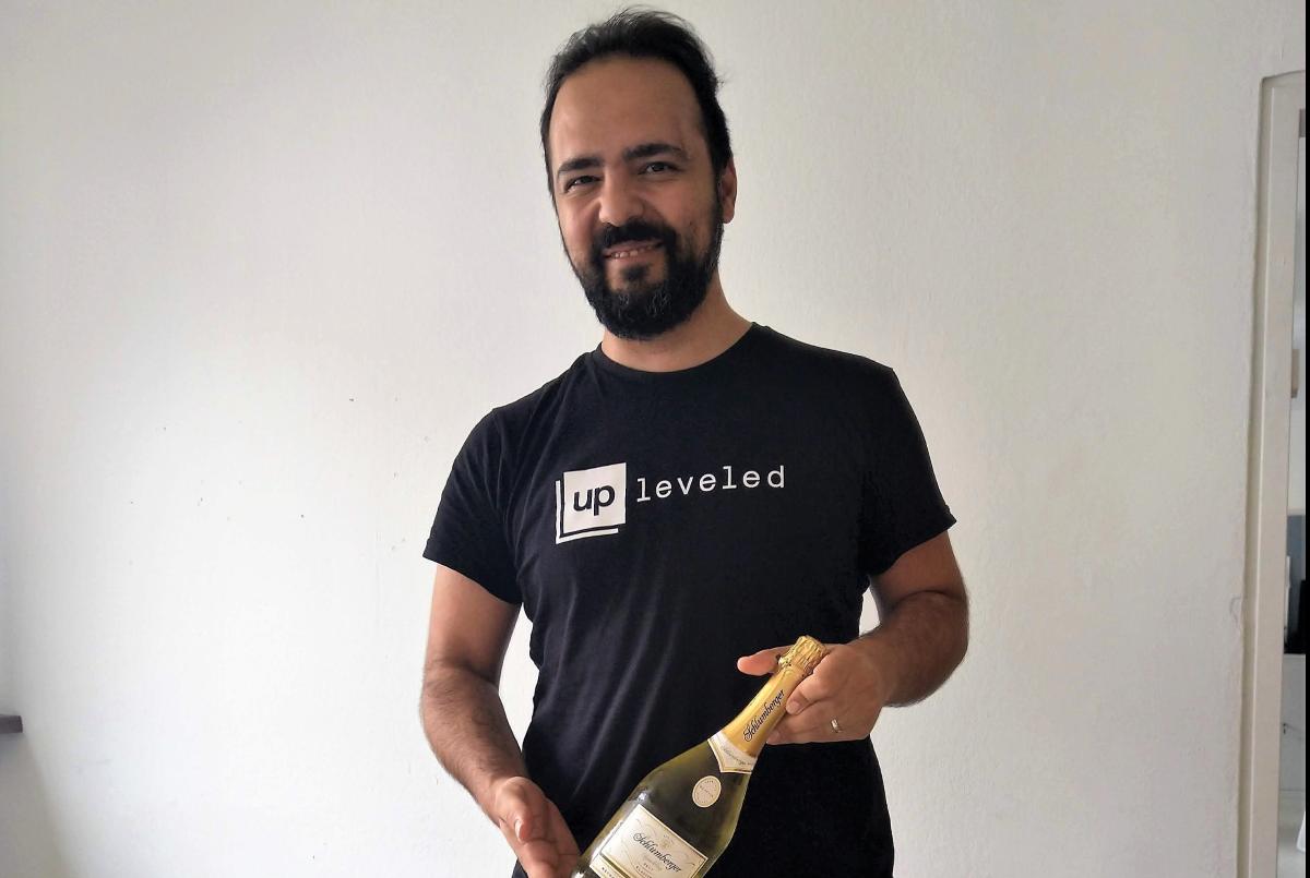 Hamed celebrating graduation with some champagne
