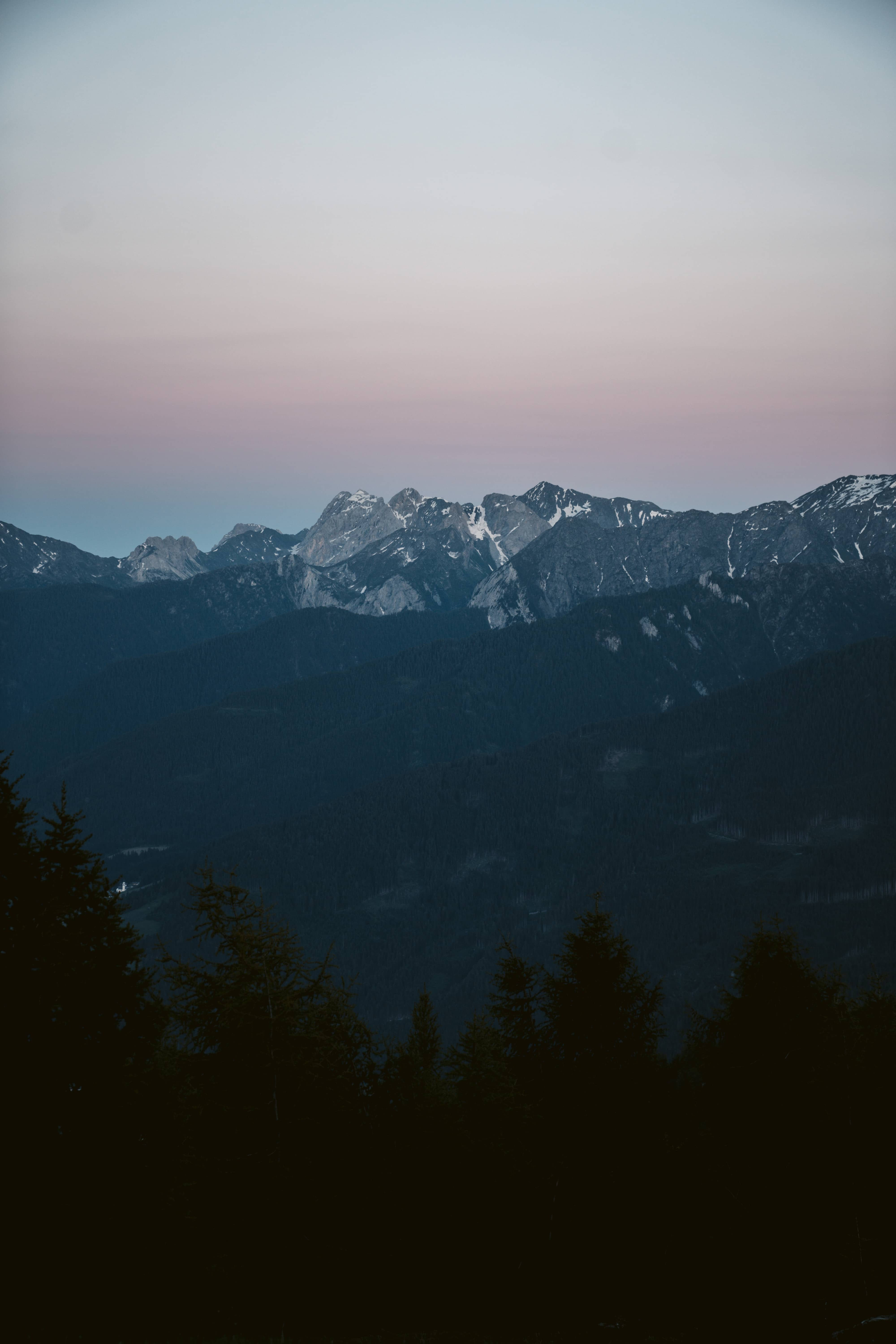 Sky colored purple above South Tyrol mountains after sunset