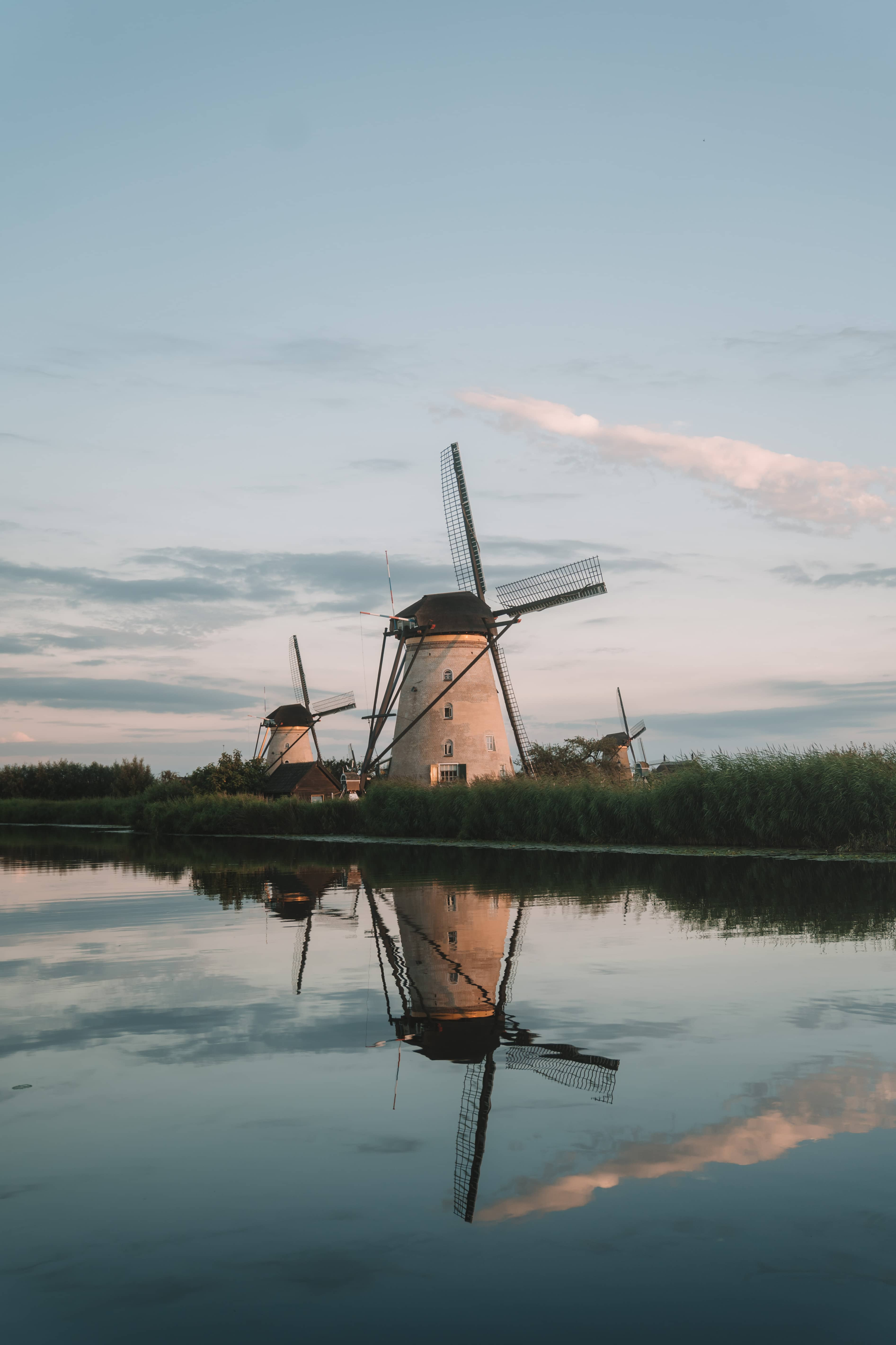 Kinderdjik windmill in Netherlands reflecting in the river while sunset
