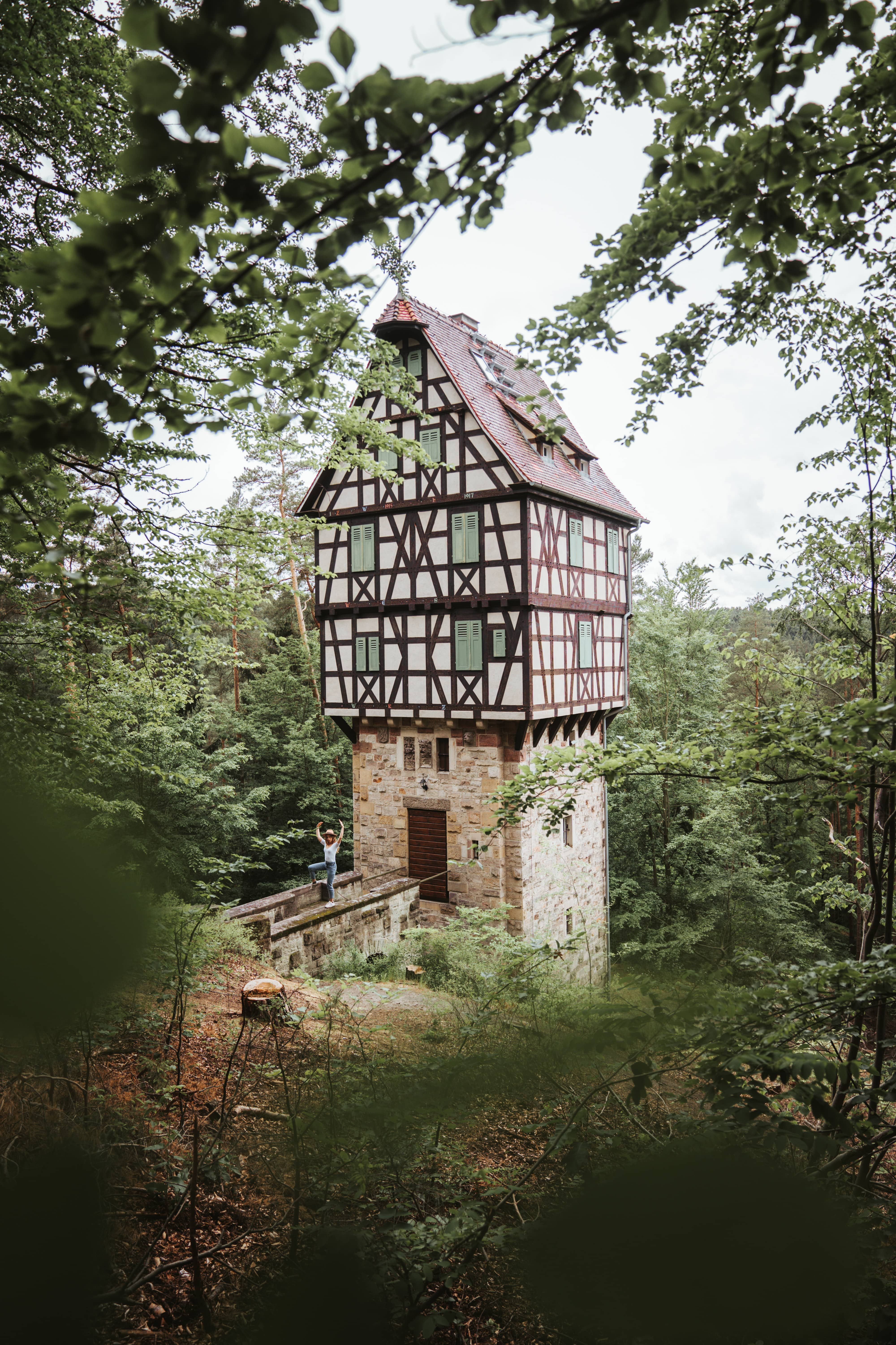 tower shaped building in the middle of Thüringen Germany surrounded by forest