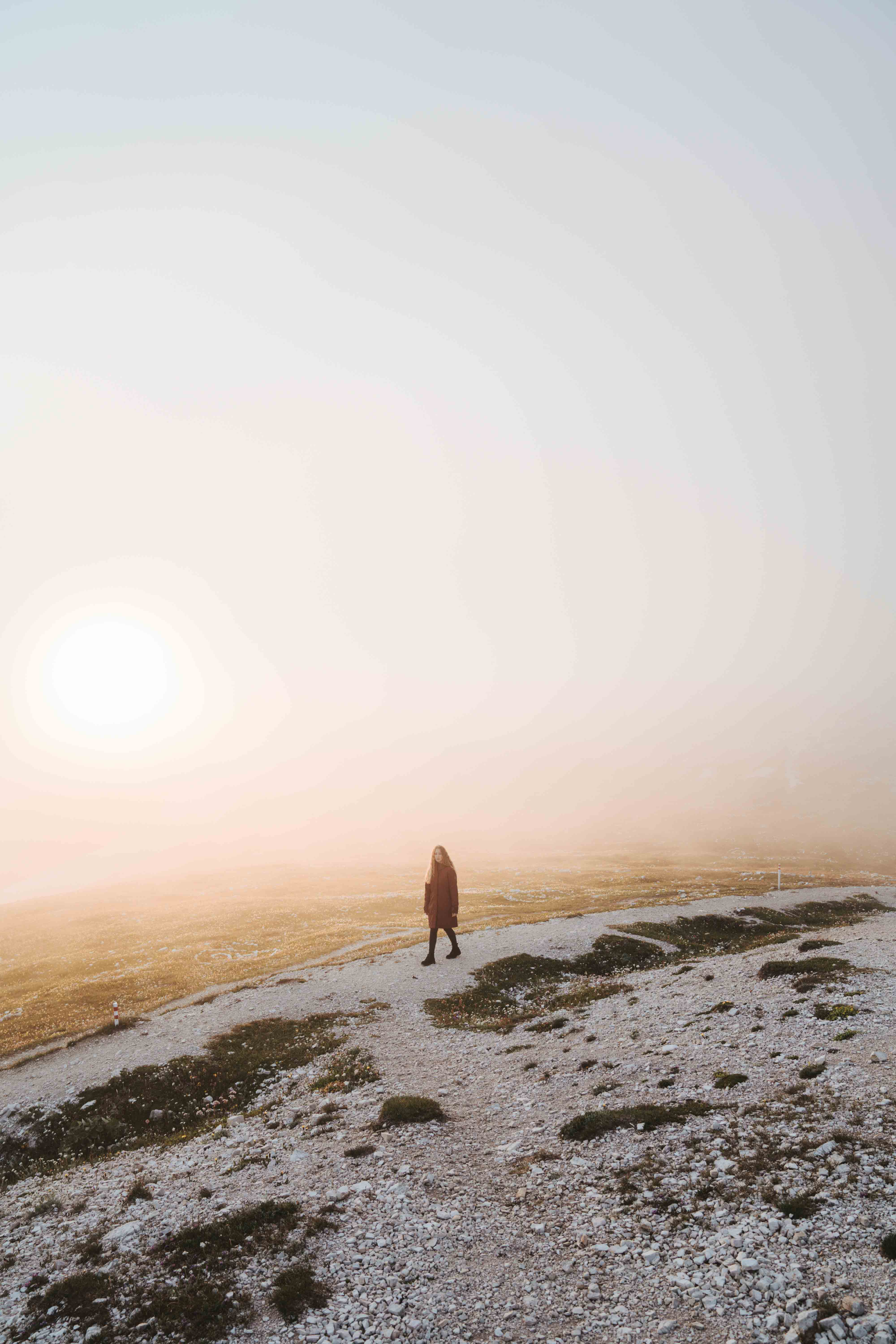 person standing alone in orange glowing fog