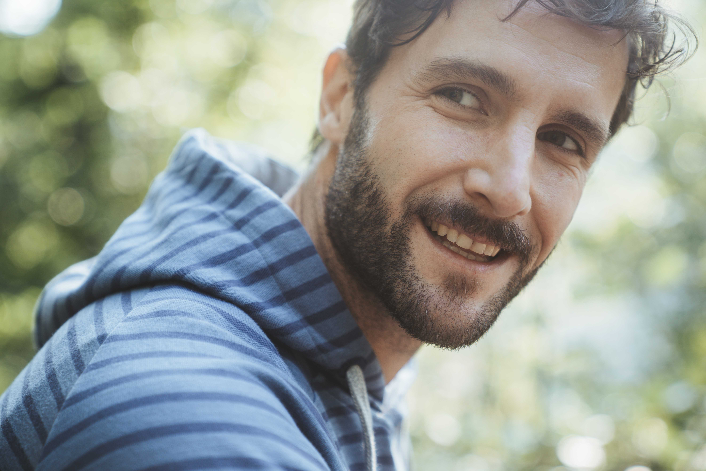 Man with beard wearing a blue striped shirt by Elkline