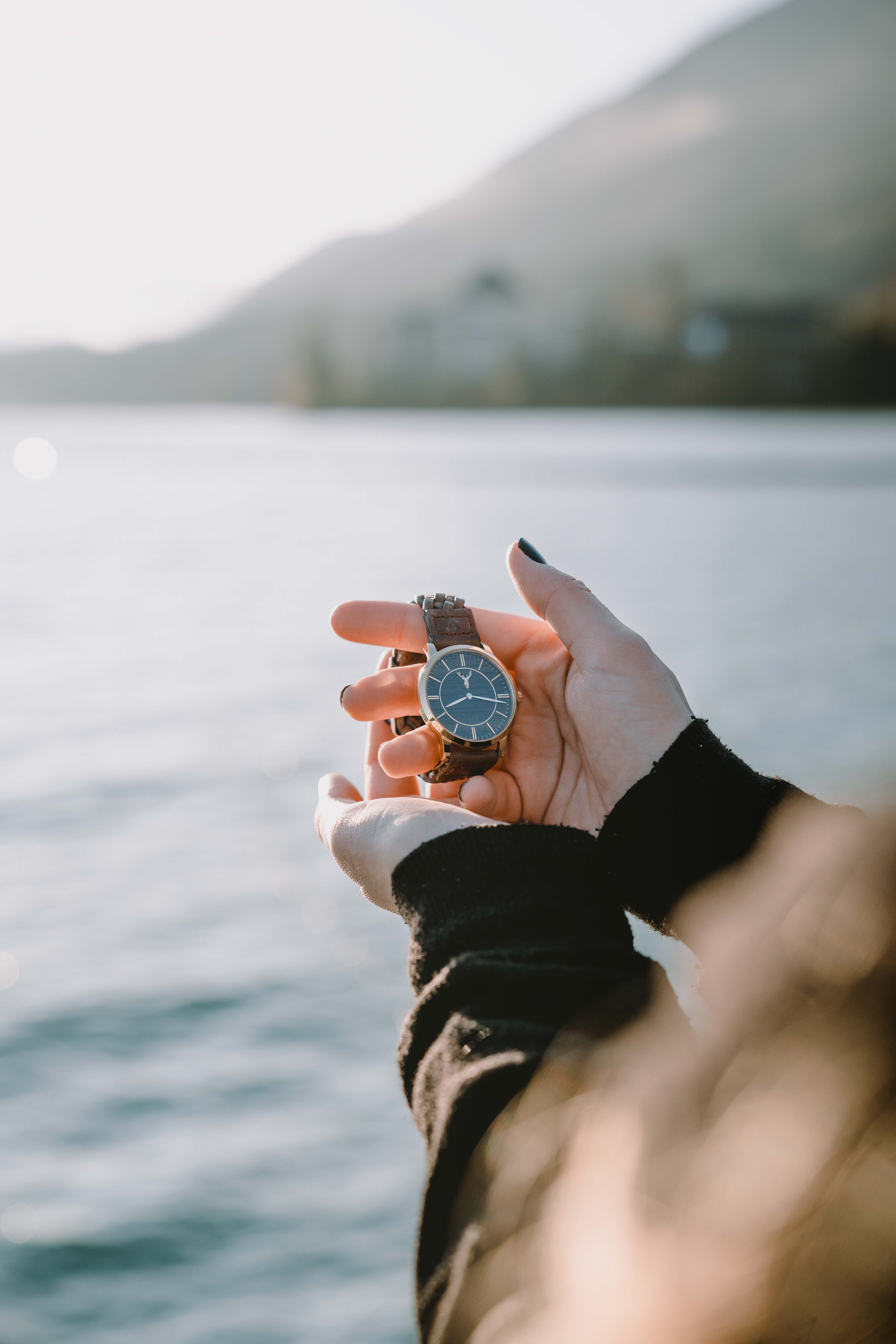 Timber&Jack wrist watch held in hands at lake